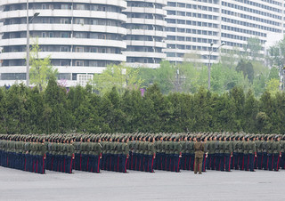 North Korean women military parade in the street in front of buildings, Pyongan Province, Pyongyang, North Korea