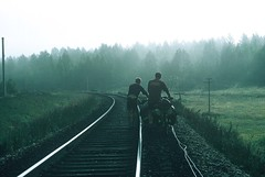 7c. Pushing our bikes along the Trans-Siberian railway line when the roads were impassable in the Swamp