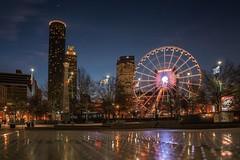 Atlanta olympic park (reinaroundtheglobe) Tags: atlanta georgia olympicplaza morning bluehour ferriswheel cityshot cityscape empirestatebuilding skyscrapers usa city lowangleview lowlight