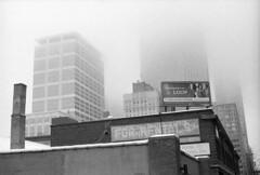 loop (kaumpphoto) Tags: fog sign billboard loop street urban tall atmosphere mamiya nc1000s ilford 3200 photography bw brick chimney glass minneapolis downtown wall north clinic pharmacy rental grain