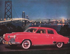 """Magazine Ad:  """"Announcing the New 1951 Studebaker . . . The Thrifty One For '51."""" Model shown is the Commander State 4-door Sedan (lhboudreau) Tags: vehicle car drawing illustration automobile auto cars drawings illustrations automobiles autos magazine magazines 1951 studebaker commander commanderstate vintagecar classiccar sedan 4doorsedan ad advertising carad advertisement autoad automobilead red redcar bridge city lights river announcement newcarannouncement magazinead night whitewall whitewalls whitewalltires skyline sky people suspensionbridge vintageautomobile thriftyone whitesidewalltires boat"""
