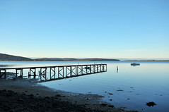 Jetty | St Helens, Tasmania (Ping Timeout) Tags: tasmania tassie state australia vacation holiday june 2017 island south commonwealth oz bass strait hobart tas outdoor blue sky silhouette binalong bay water lagoon wood wooden low sun afternoon evening sunset sand soil landscape reflection reflect serenity senere peace simple peaceful scene scenery beautiful east sea beach vessel boat inlet wide angle 1024 saint st helens bridge