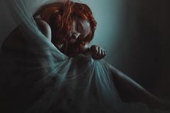 The Muse (Laura Callsen) Tags: ginger red redhead dark female fragile fabric cyan people portrait model melancholy vsco grain