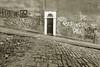 Door on a Hill (weirdoldhattie) Tags: bristol kingsdown hill steep door doorway cobbles bw blackandwhite monochrome graffiti streetart art