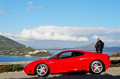 Obiettivi diversi... (antonè) Tags: ferrari rossa portoconte capocaccia alghero sardegna panorama fotografo turista auto cielo nuvole mare antonè car