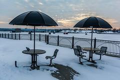 see you next summer (TAC.Photography) Tags: umbrellas tapleseat outdoor outdoorseating saginawriver froze ice freeze winter baycity wenona snow evening tacphotography d7100 tomclarknet