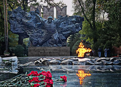 Soviet WWII Memorial - Almaty, Kazakhstan (mattleof) Tags: sony rx100 m4 mattfredrickson fredrickson city photo photos photography light orange orangecounty california ca photographer mattleof soviet wwii memorial panfilov heroes guardsmen eternal flame flowers red yellow black soldiers war bravery park statue russian kazakhstan almaty 2017
