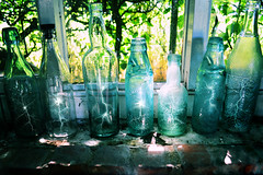 Bottled Lightning (Matt West) Tags: bottle bottles lightning old idiom glass expression sunlight brick window shelf ledge antique epigram
