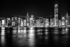 Hong Kong Skyline (Sniper Zaytsev) Tags: cityscape zeiss 35mm hong kong skyline famous light monochrome black white festive buildings urban kowloon victoria harbour water boats junk sail reflections night dark
