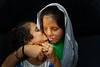 Shabnam, 27, with her daughter (silvia.alessi) Tags: travel survival asia people society photojournalism skin portrait ngc stopacid woman agra india mother child
