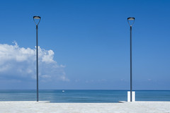 Two street lamps at the seaside (Jan van der Wolf) Tags: map178304v streetlamp streetlight straatlantaarn lamppost sicily sea seascape seaside dissymmetry clouds wolken sky landscape