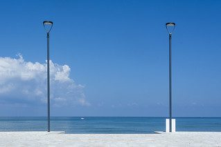 Two street lamps at the seaside