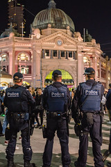 Keeping an Eye (SemiXposed) Tags: australian police melbourne white night outdoors sony people crowd men cbd flinders street station uniform