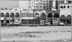 Unusual Array of Shops - Muscat (stevebfotos) Tags: muscat vendor reviewtodelete bw monochrome oman butcher muscatgovernorate om