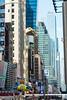 Golden Hand, Madame Tussaud's (MikePScott) Tags: architecturalfeatures banner billboard buildings builtenvironment camera clock featureslandmarks flag logo madametussauds monument newyork newyorkcity nikon28300mmf3556 nikond800 sculpture sign sky skyscraper timessquare usa