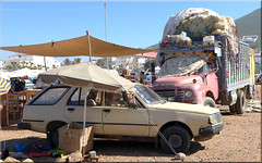 old - but still in charge (mhobl) Tags: morocco sidiifni car truck market bedford parasol tent