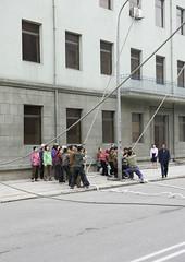 North Korean people pulling on ropes in the street, Pyongan Province, Pyongyang, North Korea (Eric Lafforgue) Tags: 6806 adultsonly asia communism construction dailylife day determination dictatorship dprk dragging effort groupofpeople helping men motivation northkorea outdoors people pulling pyongyang road rope ropes street streetscene strength struggle teamwork vertical women workers working pyonganprovince 北朝鮮 북한 朝鮮民主主義人民共和国 조선 coreadelnorte coréedunord coréiadonorte coreiadonorte 조선민주주의인민공화국 เกาหลีเหนือ קוריאההצפונית koreapółnocna koreautara kuzeykore nordkorea північнакорея севернакореја севернакорея severníkorea βόρειακορέα