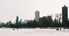 On the Ice (thedailyjaw) Tags: nikonfe nikon analog filmphotography film ektar100 ektar chicago skyline skyscraper skyscrapers skyview cityscape snow skating ice iceskating blades fishing