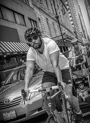 Biking in the streets of Chicago..... (Kevin Povenz Thanks for all the views and comments) Tags: 2015 june kevinpovenz illinios chicago street streetphotography blackandwhite bw male rider bike city windycity helmet white look man arms guns