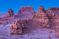 Sandstone Hoodoos at Twilight In Goblin Valley State Park (Lee Rentz) Tags: april entradasandstone goblinvalley goblinvalleystatepark hanksville jurassic sanrafaeldesert sanrafaelswell afterglow alien america bluehour color eroded erosion evening formation formations geologic geological geology goblins hoodoo hoodoos landscape late mushroomshaped natural nature northamerica orange park planet sandstone shape shapes southwest southwestern spring statepark strange surreal twilight us usa utah valley weathered weird wild