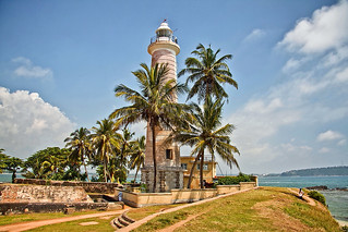 Lighthouse under palm trees