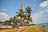 Lighthouse under palm trees (Zoom58.9) Tags: leutturm palmen ozean meer himmel bäume küste lanka lighthouse ocean sea wasser water sky canon eos 50d