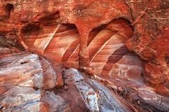 The Lie-Smile Arch (Ramen Saha) Tags: rocks redrock sandstone rockformation valleyoffirestatepark nevadastatepark nevada emotion ramensaha abstract valleyoffire