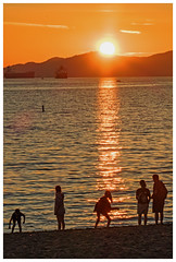 Skipping Stones at Sunset (HereInVancouver) Tags: sunset family skippingstones candid ocean water pacific mountains vancouverswestend englishbay sunsetbeach vancouver bc canada canong15 thingstodobythewater