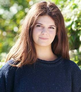 Girl in navy knit wool sweater