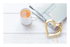 32/365: Light-hearted (judi may) Tags: 365the2018edition 3652018 day32365 01feb18 books heart stilllife flatlay mug white wood cupoftea tea photographybooks tabletopphotography canon7d highkey 50mm openheart goldheart soft softness negativespace