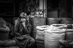 A young spice seller ..... (impressionsbyatifm) Tags: blackandwhite bnw photography streetphotography streetportraits pakistan people life light nikon