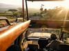 Amaneciendola (Don César) Tags: africa tanzania safari tansania gamedrive bestday driver sunrise amanecer amarillo yellow top convertible sun sol person guide