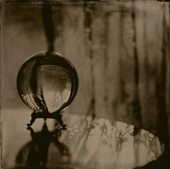 Through a Glass (angiebrockey) Tags: wetplatecollodion wetplate collodion tintype squareformat largeformat largeformatcamera crystalball glass globe mystery lace curtains table light sunlight darkroom alternativephotography