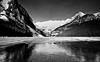 Lake Ice Building Up (Bruce vdS) Tags: canada alberta lake ice monochrome bw blackandwhite contrast reflections rockymountains canadian rockies kodachrome transparency slide on1photoraw2018 lakelouise minolta x700