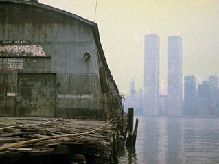 The World Trade Center looms over a placid, smoky, smoggy day in Lower Manhattan. It was so quiet that I could hear echoes of cars honking all the way across the Hudson River. Jersey City. March 1975