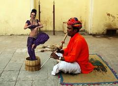 Lady charmer (sirhowardlee) Tags: snakecharmer lady woman photomanipulation basket flute mat turban sitting