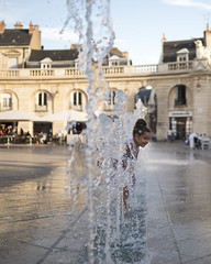 Dijon, France (phil.intlekofer) Tags: dijon france summer water child fun fountain square sunset city life liberation place de la libération reflection time historic center architecture europe happiness motion sunlight traveldestinations traveling famousplace
