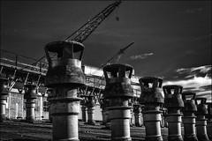 L'armée des cheminées / The army of chimneys (vedebe) Tags: noiretblanc netb nb bw monochrome abandonné usinedésaffectée chantiernaval architecture laciotat grues grue decay rue urbain urban city ville street