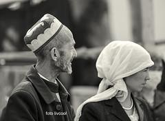 Muslim couple walking through the local market (livcool) Tags: china keriya tarim xinjiang uigur asia taklamakan karakax yurungkash blackjade jade whitejade market