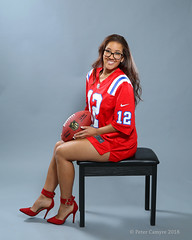 Emma - Brady Jersey (Peter Camyre) Tags: studio portrait seated pose female model friend posing tom brady jersey new england patriots football nfl game ball picture canon 5d mkiii peter camyre photography glasses smile happy sports attire fashion red heel high heels lady girl color flickr colorful