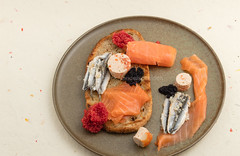 Salmon, anchovy, sturgeon eggs, salmon eggs, fish terrine and grilled bread. (annick vanderschelden) Tags: smoked salmon slices golden decorative surface fish food smokedsalmon vinegar salmosalar protein bread roasted light anchovy garlic eggs sturgeon terrine cod whiting mullet