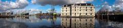 Scheepvaartmuseum panorama (PaulHoo) Tags: fujifilm x70 fuji 2018 amsterdam city urban pano panorama reflection water scheepvaartmuseum voc vessel boat ship cityscape sky clouds