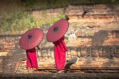 Two novices spread a red umbrella and walked into the Pa Hto Taw Gyi, Migun Mandalay Myanmar (Patrick Foto ;)) Tags: pahtodawgyi ancient architecture asia asian bagan boy brick buddha buddhism buddhist buddism building burma burmese child close closeup culture famous gyi historical hto kid landmark little mandalay mingun monk myanmar novice pa pagoda paya pray prayer priest red religion ruin standing taw temple town traditional travel walking wall worship young minkun sagaingregion myanmarburma mm