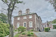 Government House (gabi-h) Tags: governmenthouse lieutenantgovernorresidence brick architecture gabih stjohns newfoundlandandlabrador windows windowwednesday gardens peaceful lovely summer lightstandards fence cloudy sky chimneys