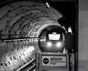 B&W of Incoming Canada Line Hyundai Rotem EMU Thru the Tunnel (AvgeekJoe) Tags: bw blackwhite blackandwhite britishcolumbia canada canadaline d5300 dslr hyundairotememu importedkeywordtags lightrail nikon nikond5300 sigma1835mmf18 sigma1835mmf18dchsmart sigma1835mmf18dchsmartfornikon sigmaartlens skytrain train translink vancouver masstransit rail transit urbanrail
