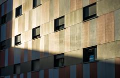 'Et lux in tenebris lucet' (Canadapt) Tags: building windows facade shadow light evening sun orange loures portugal canadapt