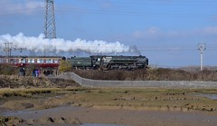 Standard Class 7 No.70013 'Oliver Cromwell' storms across the Stour Estuary at Cattawade (Manningtree) with 1Z90, Liverpool Street - Norwich Cathedrals Express. 22 02 2018 (pnb511) Tags: great eastern mainline geml river stour mud water essex suffolk estuary 70013 steam loco locomotive engine smoke