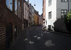 Copenhagen, 2017 (Blinkofanaye) Tags: copenhagen københavn woman denmark street shadow magstræde bike ivy summer