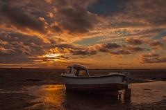 Sunset Beach (Tony Shertila) Tags: europe britain engand merseyside wirral meols beach coast boat transport sunset sky clouds horizon reflection puddle westkirbyhoylake england unitedkingdom gbr