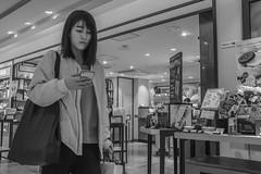 Oblivious (Bill Morgan) Tags: fujifilm fuji x100f bw jpeg acros street girl kichijoji tokyo